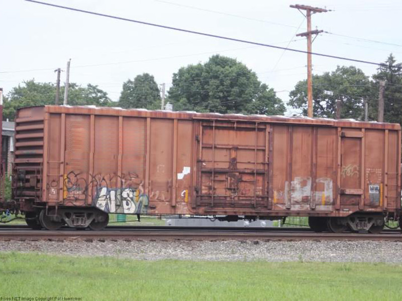Railroad car doors a local train sits with itu0027s for Railroad motor cars for sale